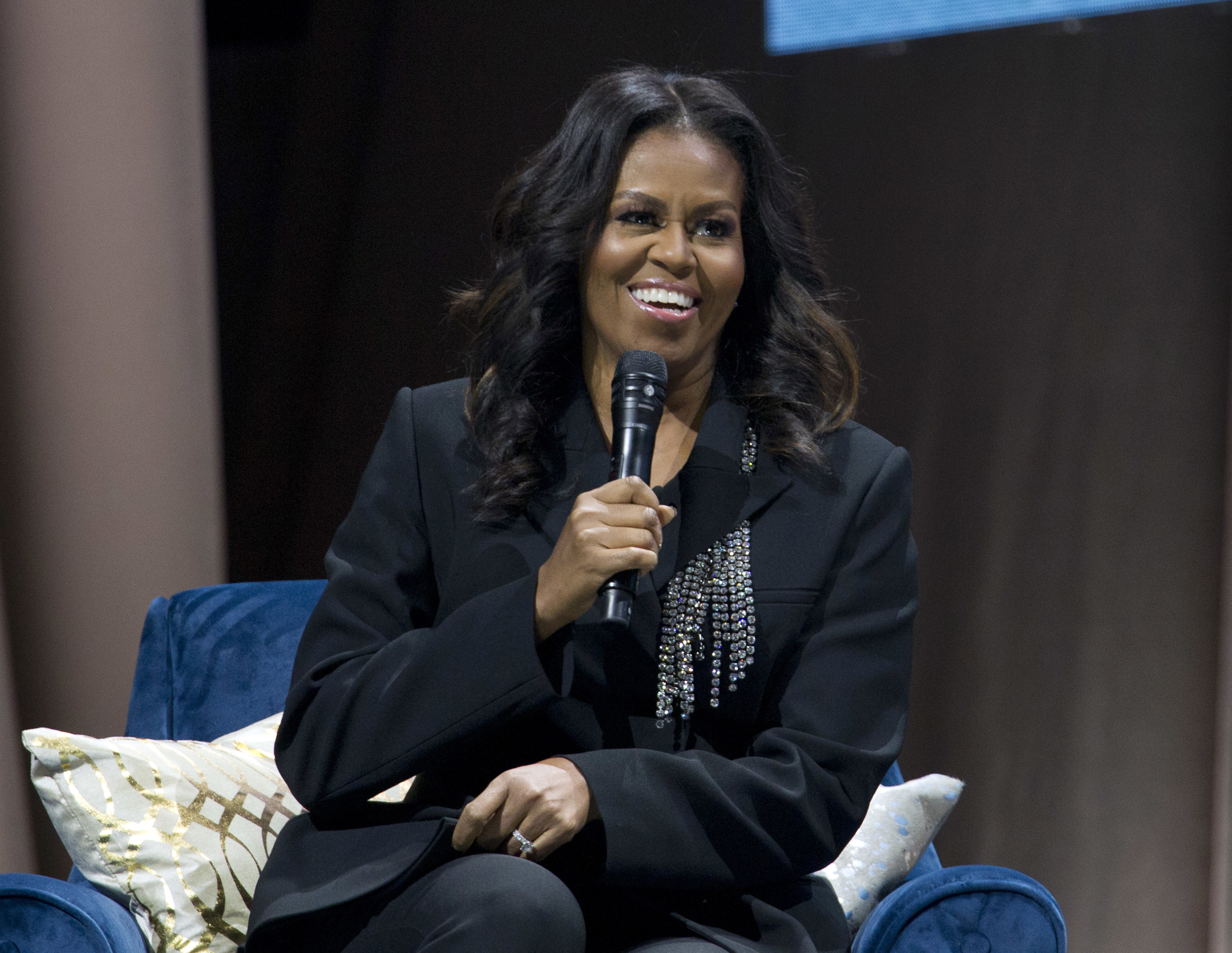 Michelle Obama speaks to the crowd as she presents her anticipated memoir Becoming during her book tour stop in Washington on Saturday.