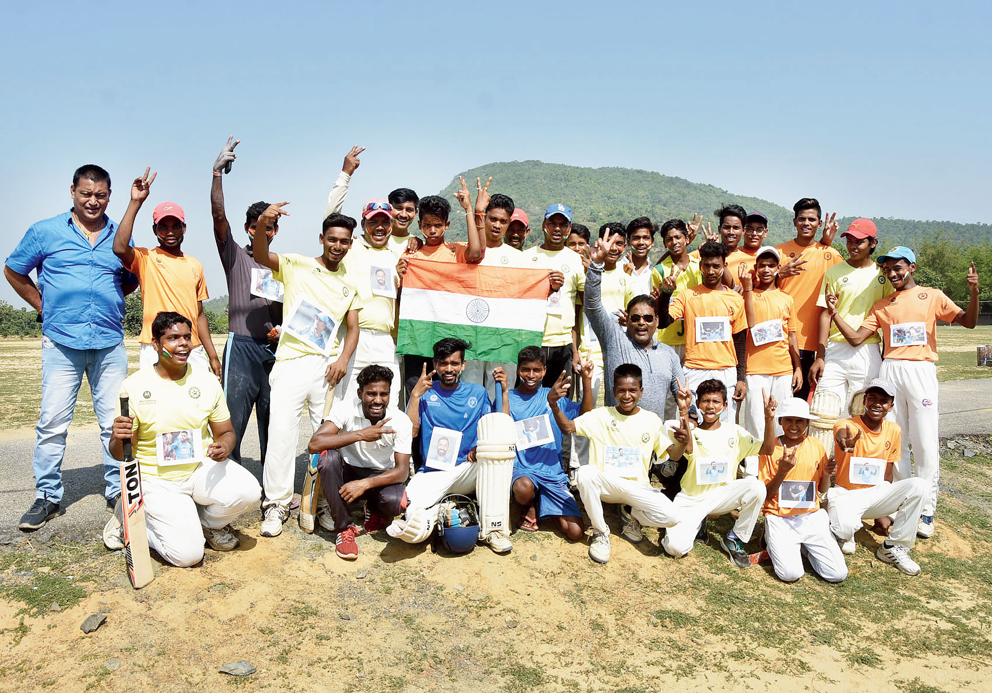 Cricketers of rebel-hit Tundi in Dhanbad cheer for Team India at the World Cup on Wednesday with their coach Umesh Srivastava (seated, with glares).