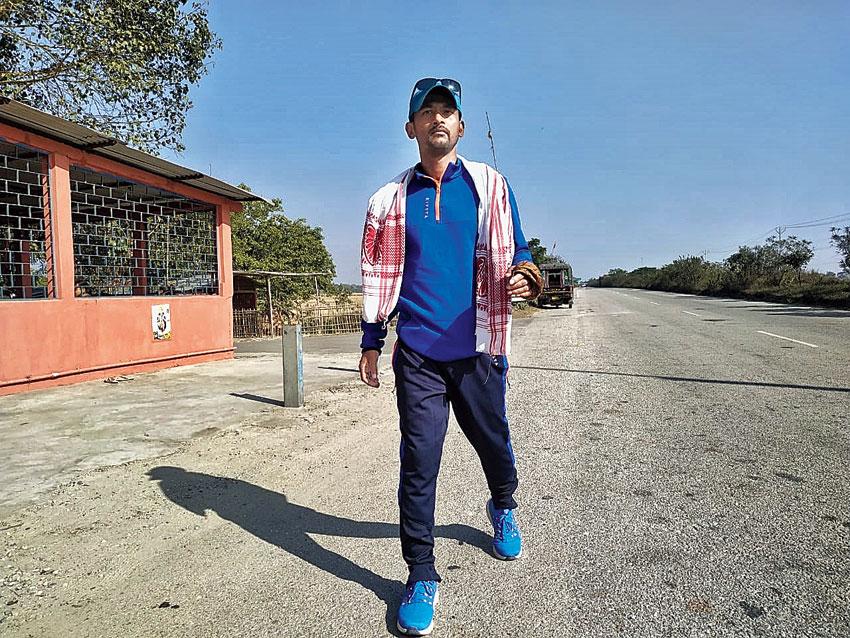 Khanin Roy walks on National Highway 31 on Saturday