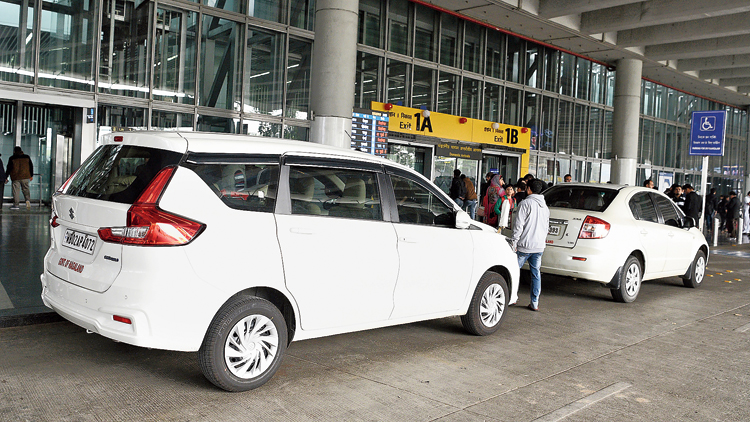"A car with the ""Government of Nagaland"" sticker pasted on it was parked in front of gate numbers 1A and 1B of the airport for over 40 minutes  on Sunday"