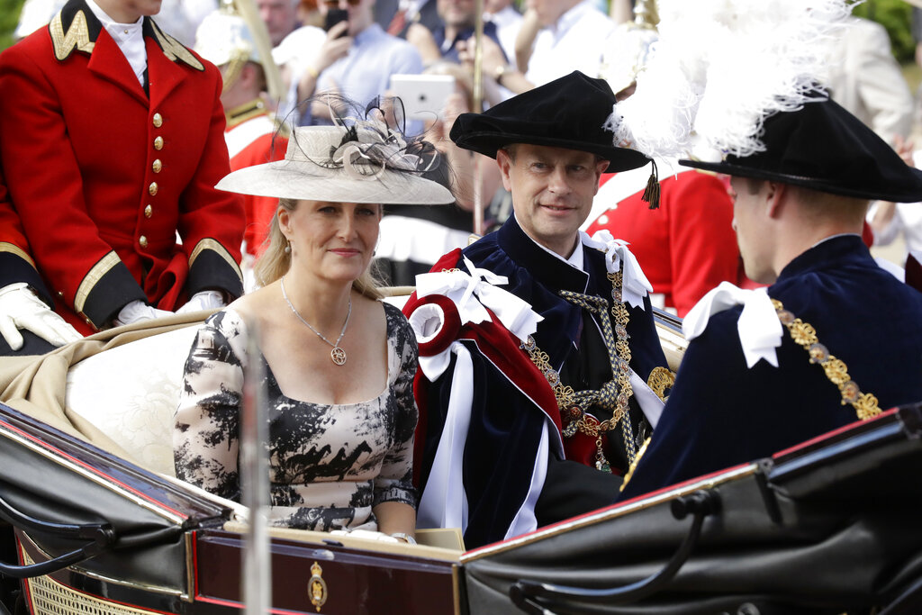 File photo of Britain's Prince Edward (center) in his role as Knight Companion and his wife Sophie, Countess of Wessex, leave in a carriage after the Order of The Garter Service at Windsor Castle in Windsor