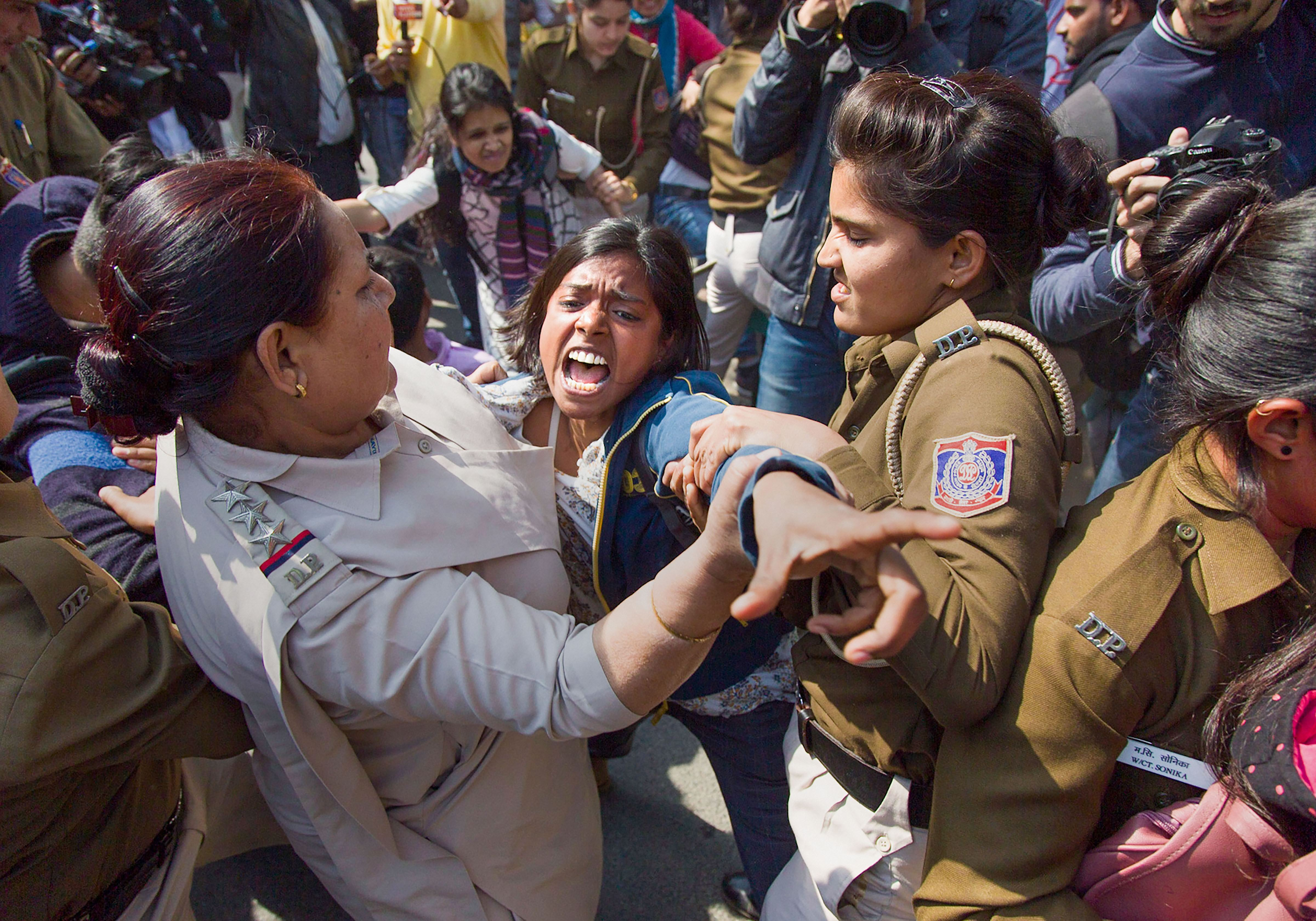 Protestors are detained by the police at UP Bhawan, in New Delhi, February 20, 2020