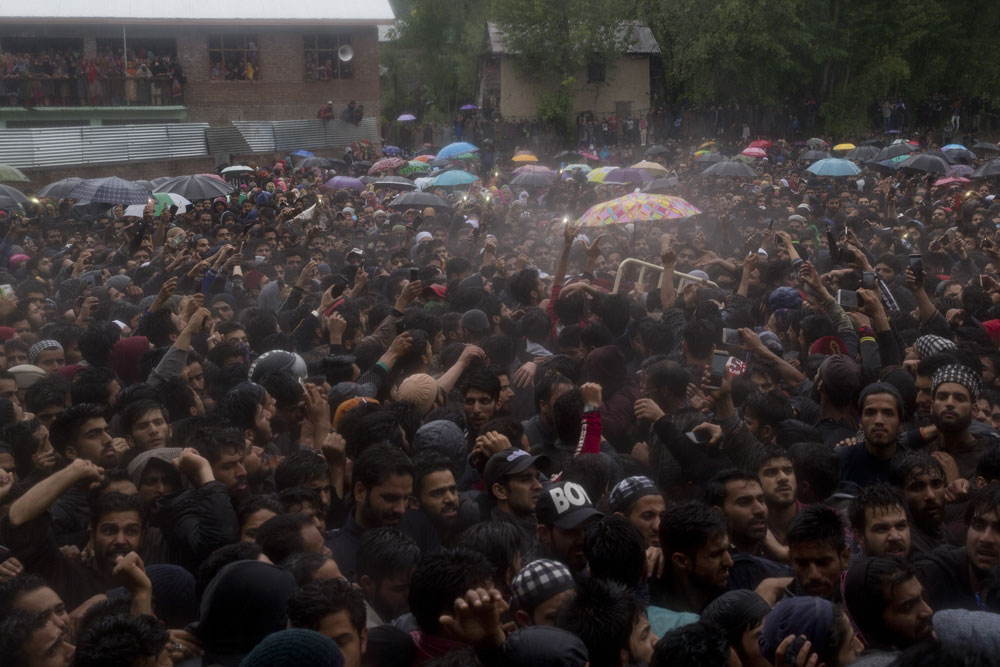 Kashmiri villagers carry the body of Zakir Musa, a top militant commander linked to al-Qaida, as it rains during his funeral procession in Tral, south of Srinagar on Friday, May 24, 2019