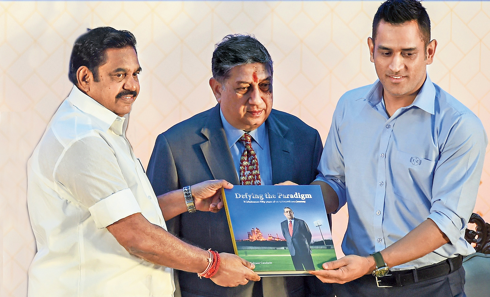 Tamil Nadu chief minister Edappadi K. Palaniswami, N.Srinivasan and Mahendra Singh Dhoni on Friday.