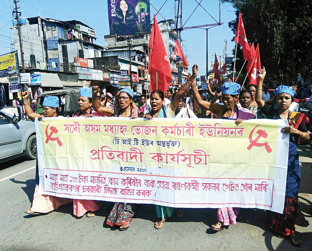 Midday meal workers take part in a protest rally in Jorhat on Wednesday