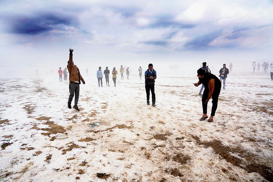 People enjoy the after-effects of hailstorm at Daltonganj