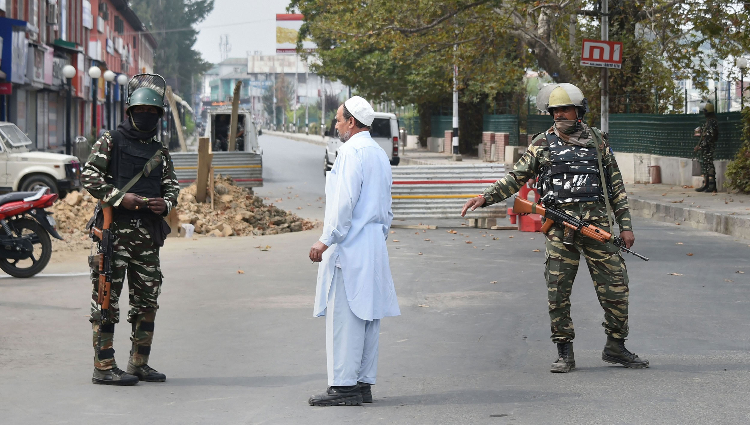 Security personnel stand guard on a road leading to Lal Chowk during restrictions in Srinagar on September 27, 2019.