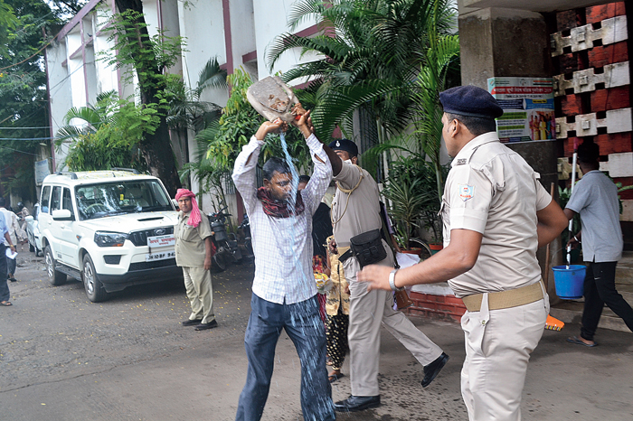 Akhtar Hawari pours kerosene on himself outside the district collectorate in Dhanbad on Wednesday