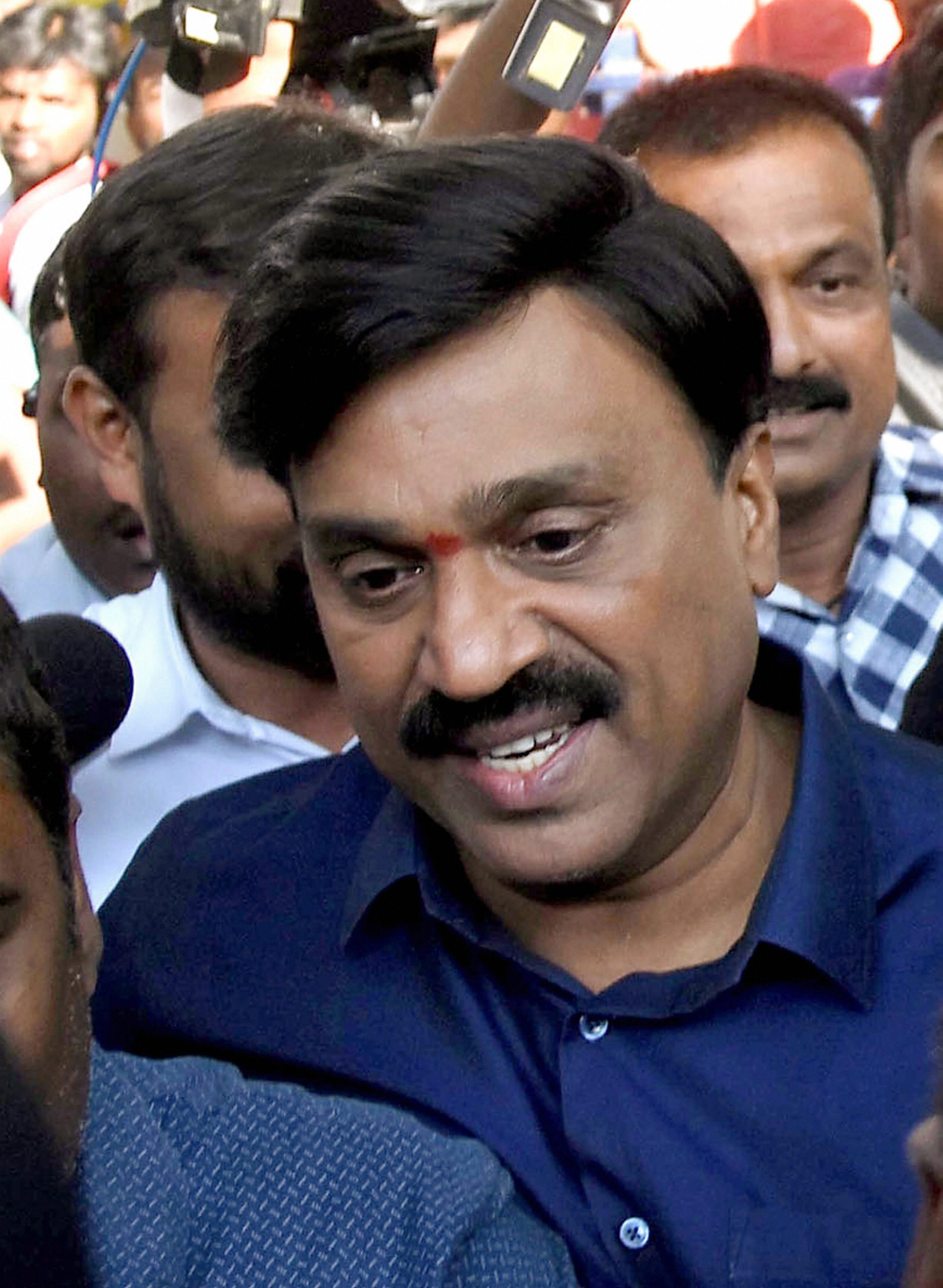Mining Baron Gali Janardhan Reddy arrives at the crime branch office in Bangalore on Saturday.