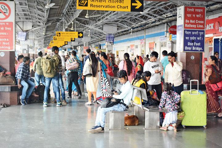 Passengers wait for trains at Tatanagar station on Saturday.