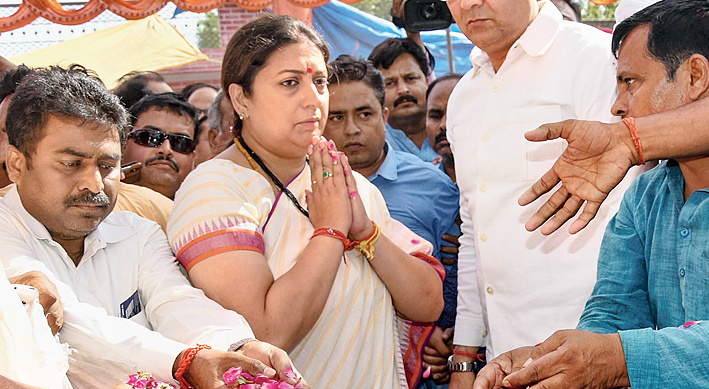 Irani pays her last respects to Surendra Singh in Amethi on Sunday.