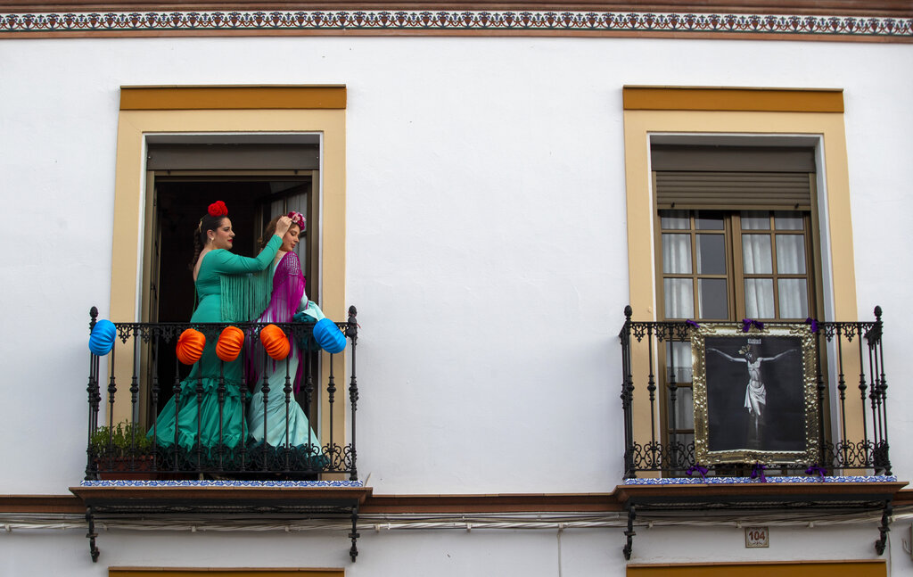 Women in traditional dress dance on their decorated balcony in the village of Mairena del Alcor, some 21 kilometres (13 miles) from Seville during the annual traditional April Fair celebrated across the southern Andulacia Provence. Without breaking the confinement rules, the residents of the village have found a novel way of continuing the tradition of the fair which has been cancelled due to the coronavirus outbreak and normally includes flamenco dancing, bullfighting, eating and drinking.
