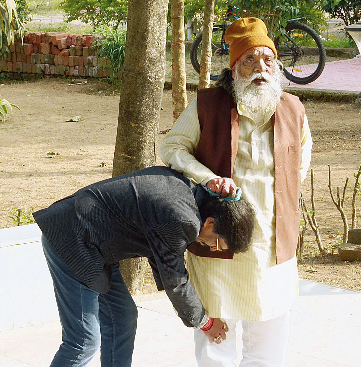 Hemant seeks blessings from his father Shibu Soren after wining the Barhait and Dumka constituencies at the  residence of Soren at Morabadi in Ranchi on Monday.
