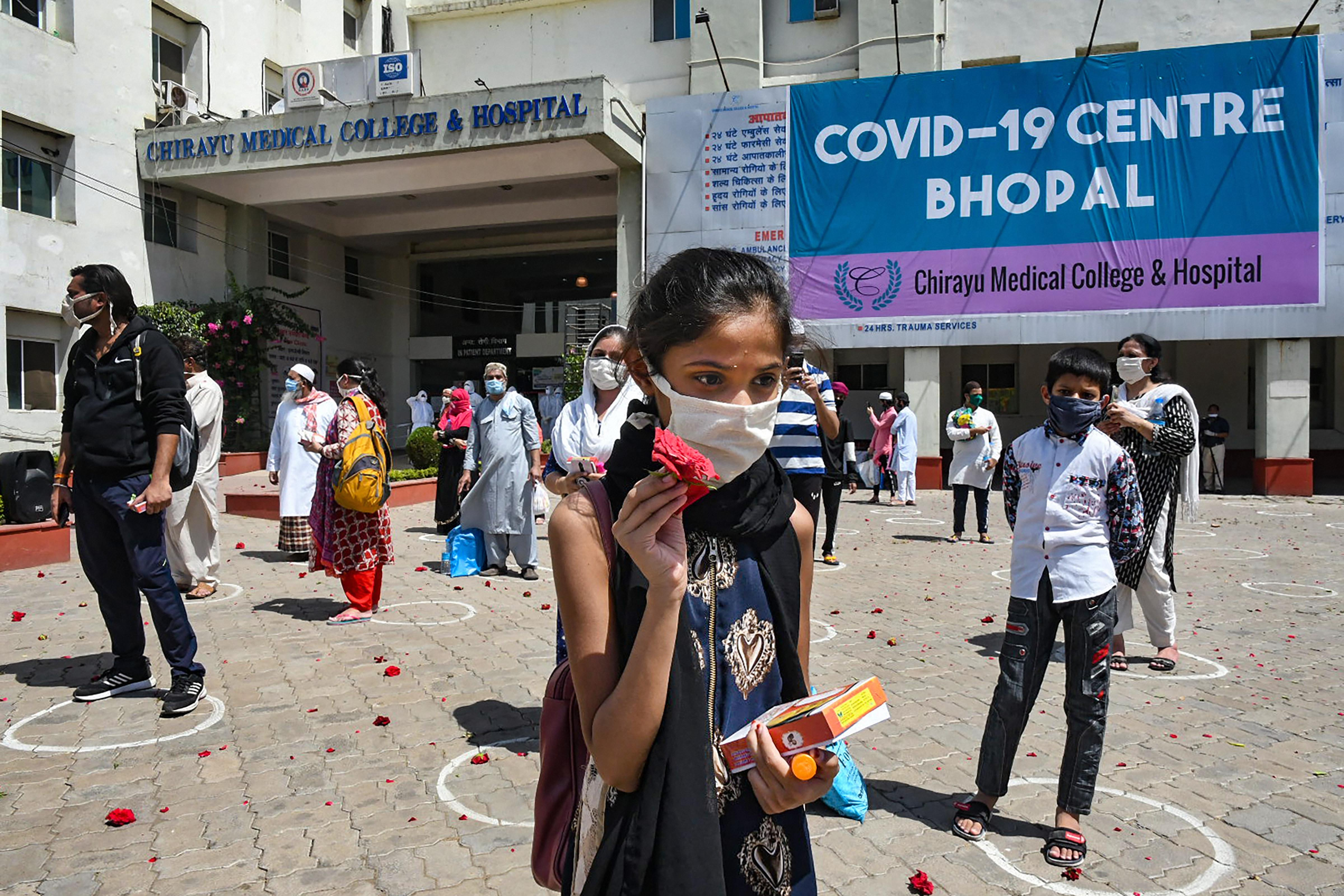 An Army bank welcomes people who recovered from Covid-19 while they are discharged from the Chirayu Hospital in Bhopal, Sunday, May 3, 2020.