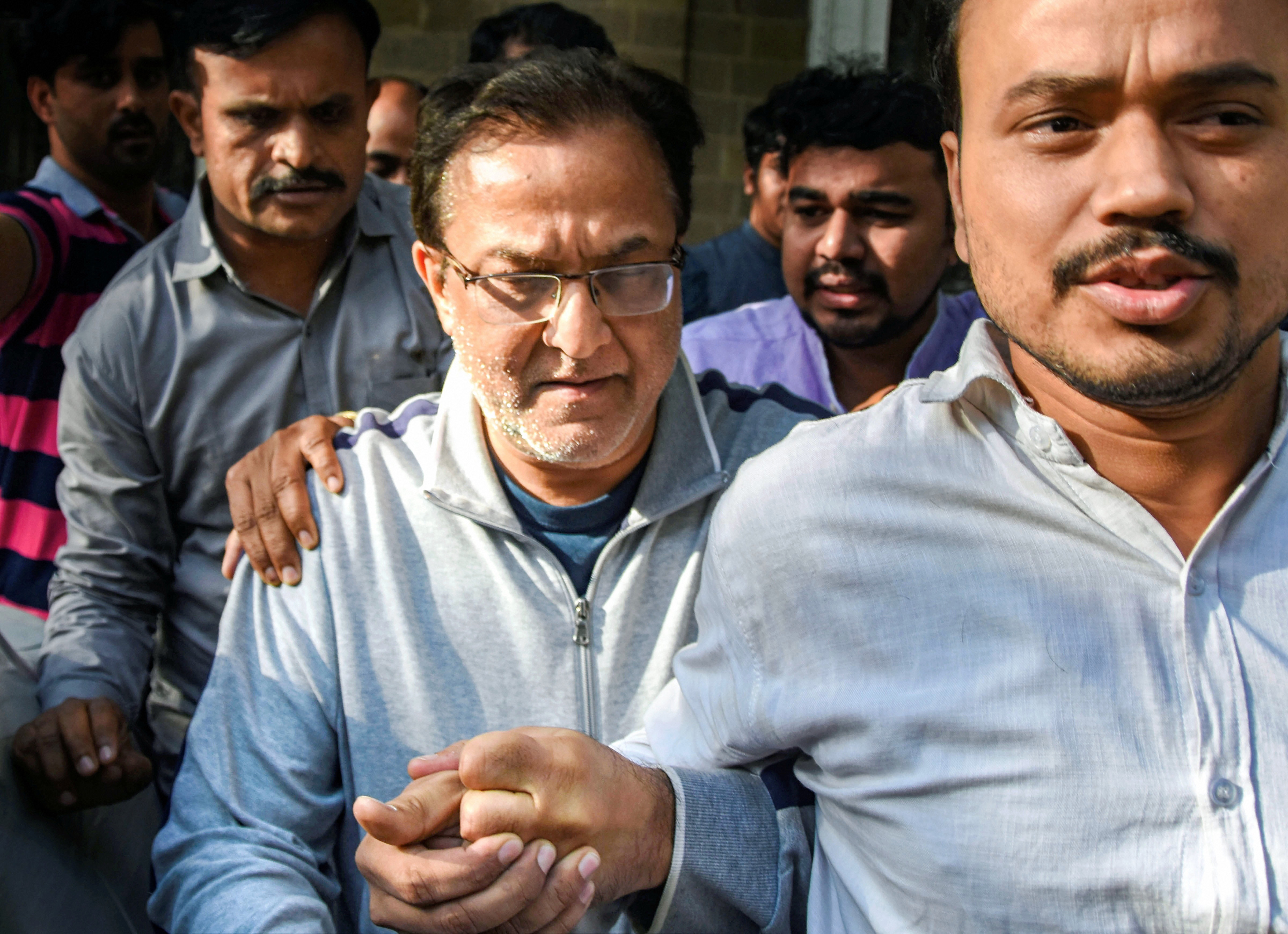 Yes Bank founder Rana Kapoor being taken to a court after being arrested by Enforcement Directorate under money laundering charges, in Mumbai, Sunday, March 8, 2020