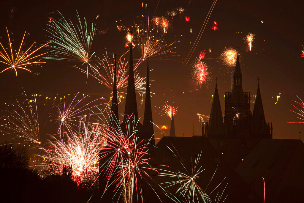 Fireworks light the sky above the St. Severi's Church and the Mariendom (Cathedral of Mary) during New Year's celebrations in Erfurt, central Germany, on Wednesday.