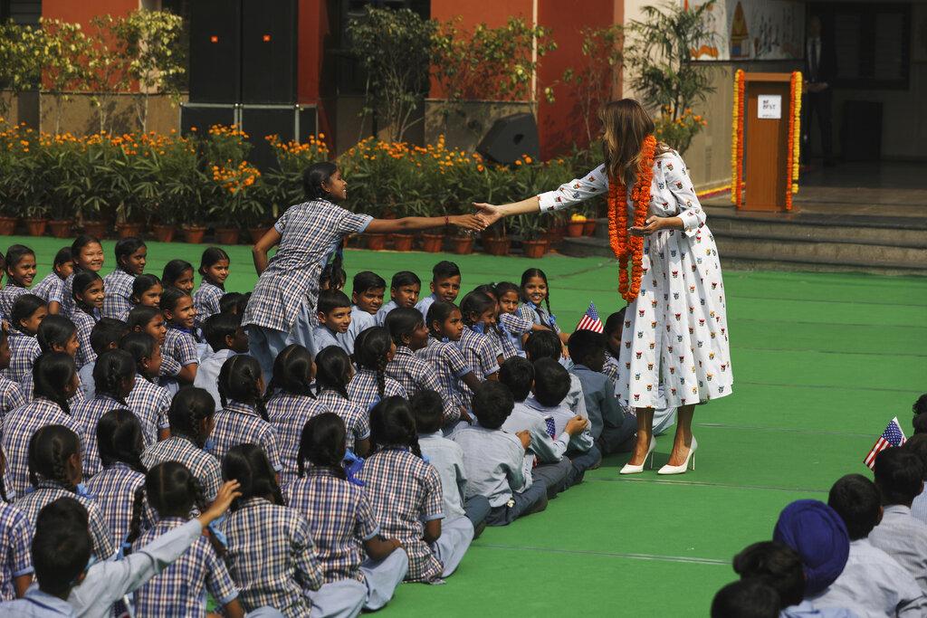 US first lady Melania Trump shakes hand with a girl at Sarvodaya Co-Educational Senior Secondary School in New Delhi