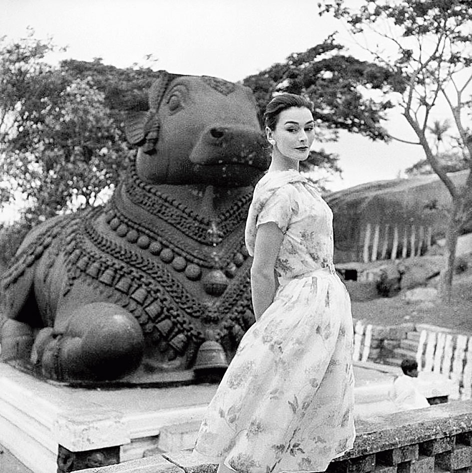 Picture taken in India of model Anne Gunning in Dior by photographer Norman Parkinson for Vogue in 1956