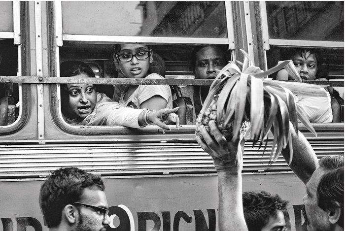 """""""It's as if the lady was buying the last pineapple of her life,"""" says Saha. """"Look at how  she is examining it in the short time available to her,"""" he urges. The expressions on the other faces too are priceless."""