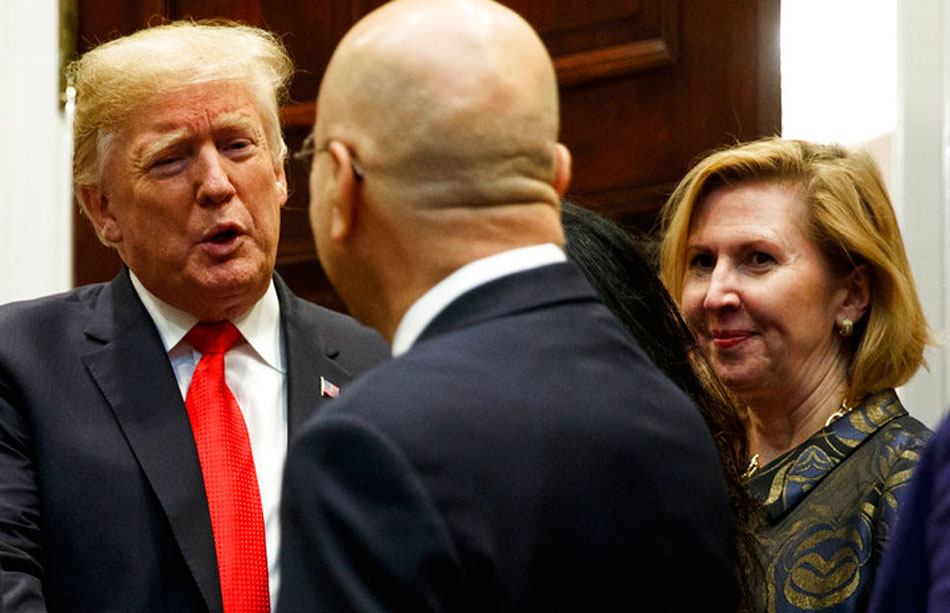 Deputy national security adviser Mira Ricardel (right) watches as President Donald Trump arrives to light a diya to mark Diwali in the Roosevelt Room of the White House on Tuesday.