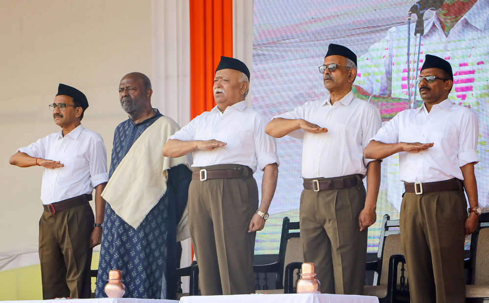 RSS chief Mohan Bhagwat (centre) in Nagpur on Tuesday. Also seen in the picture is Shiv Nadar (second from left), the HCL founder and chairman