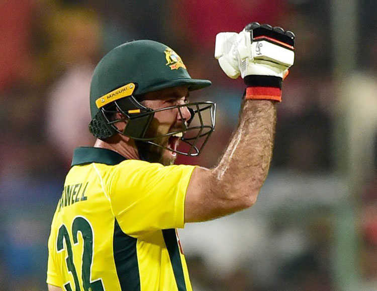 Glen Maxwell celebrates after playing the winning shot against India during the 2nd T20 match between India and Australia at Chinnaswamy Stadium in Bangalore on Wednesday