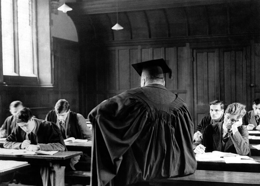 In this December 8, 1938 file photo, Cambridge University students sit during a lecture in Cambridge, England.