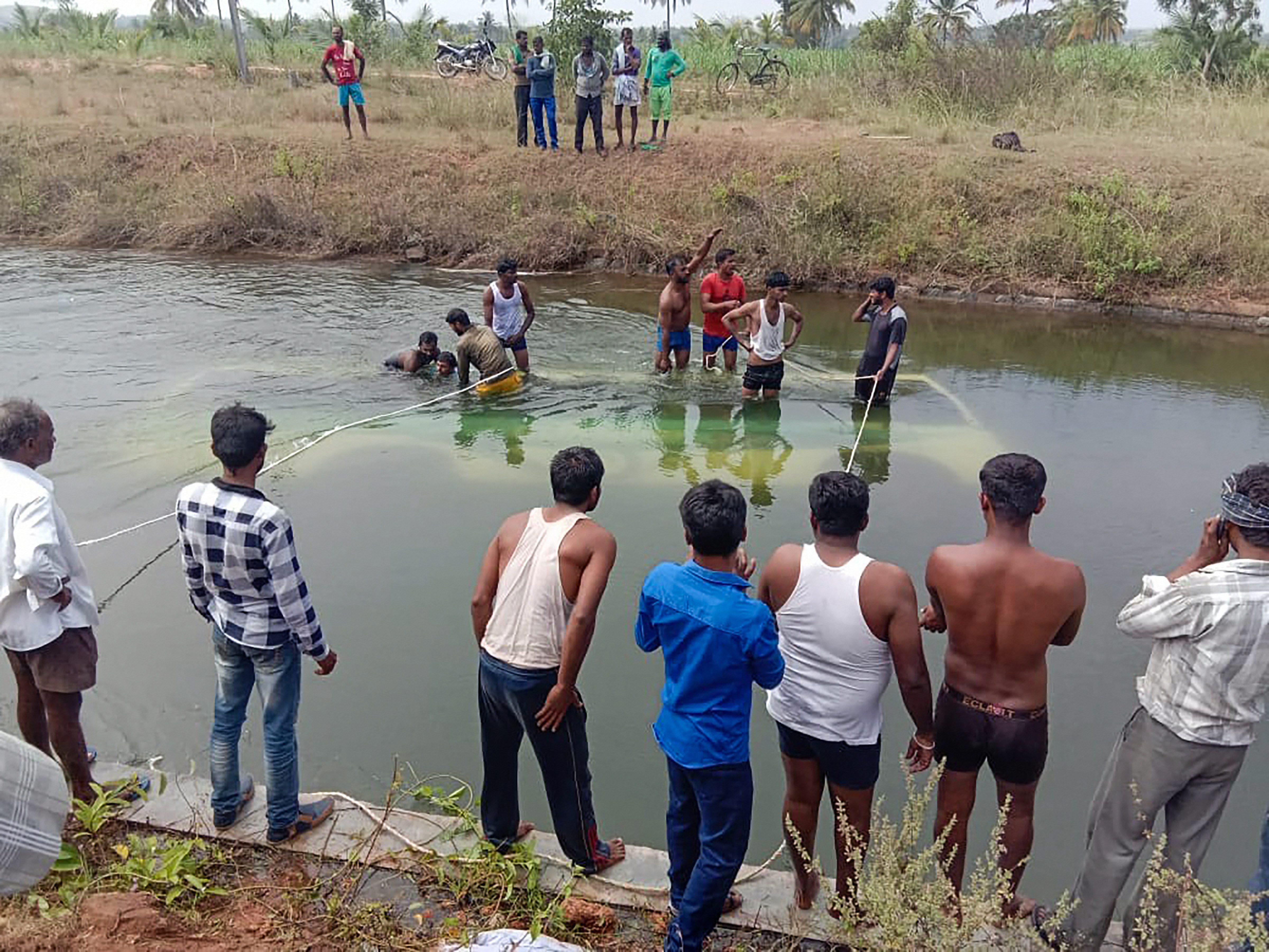 People carry out rescue work at the accident site on Saturday.