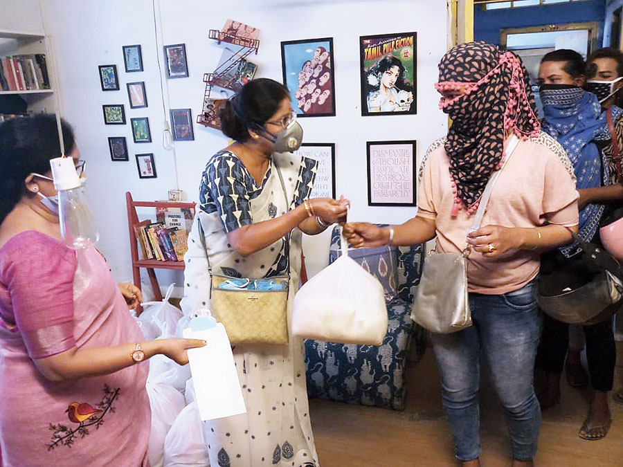 (From left) Ministers Chandrima Bhattacharya and Shashi  Panja at a ration distribution drive for the transgender community on Friday