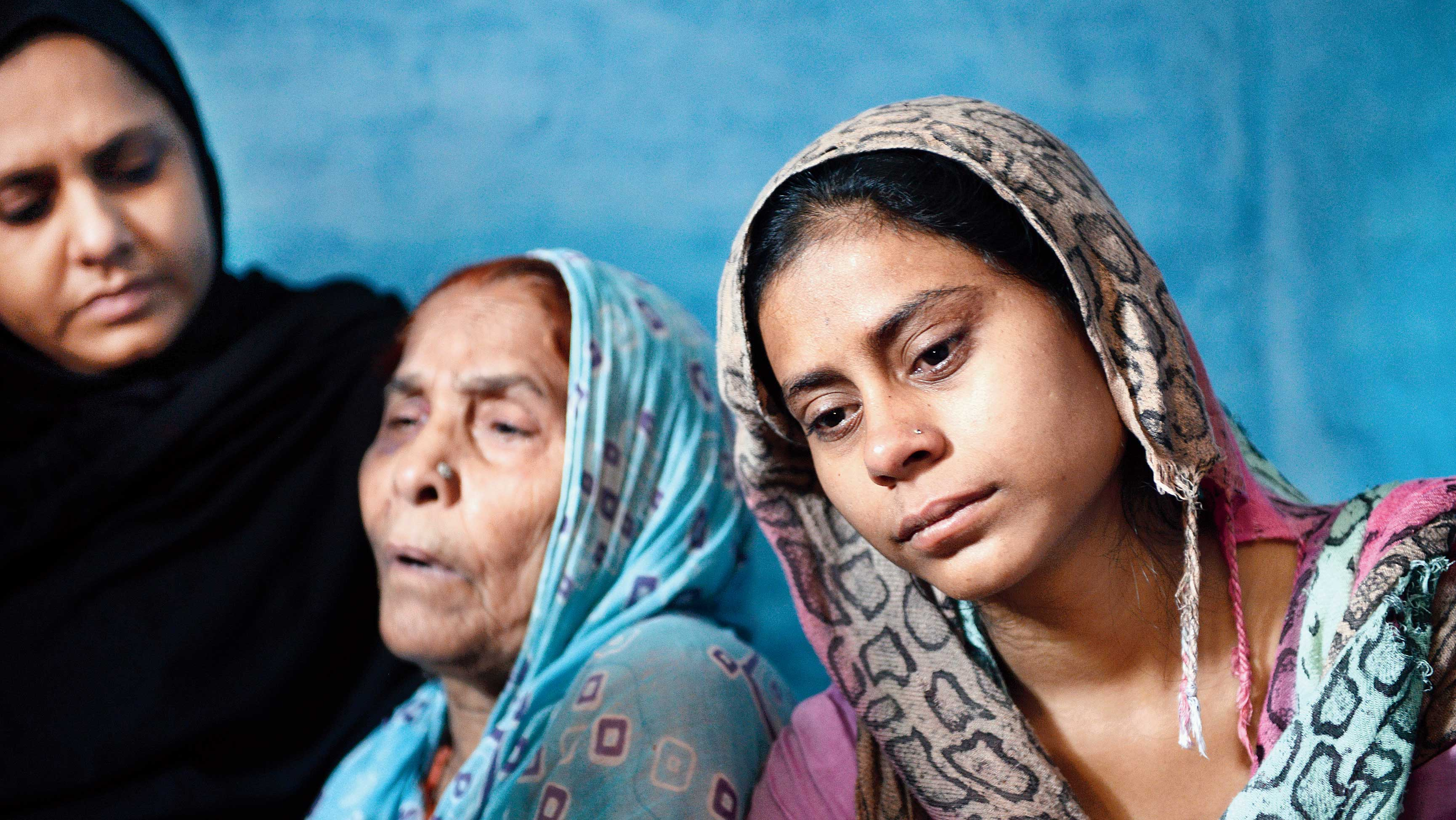 Akhlaque's mother Asgari Begum (centre) and his daughter Shaista (right) at their Bisara home in Dadri in September 2015. Asgari Begum was also beaten up by the raiding mob when she tried to save her son.