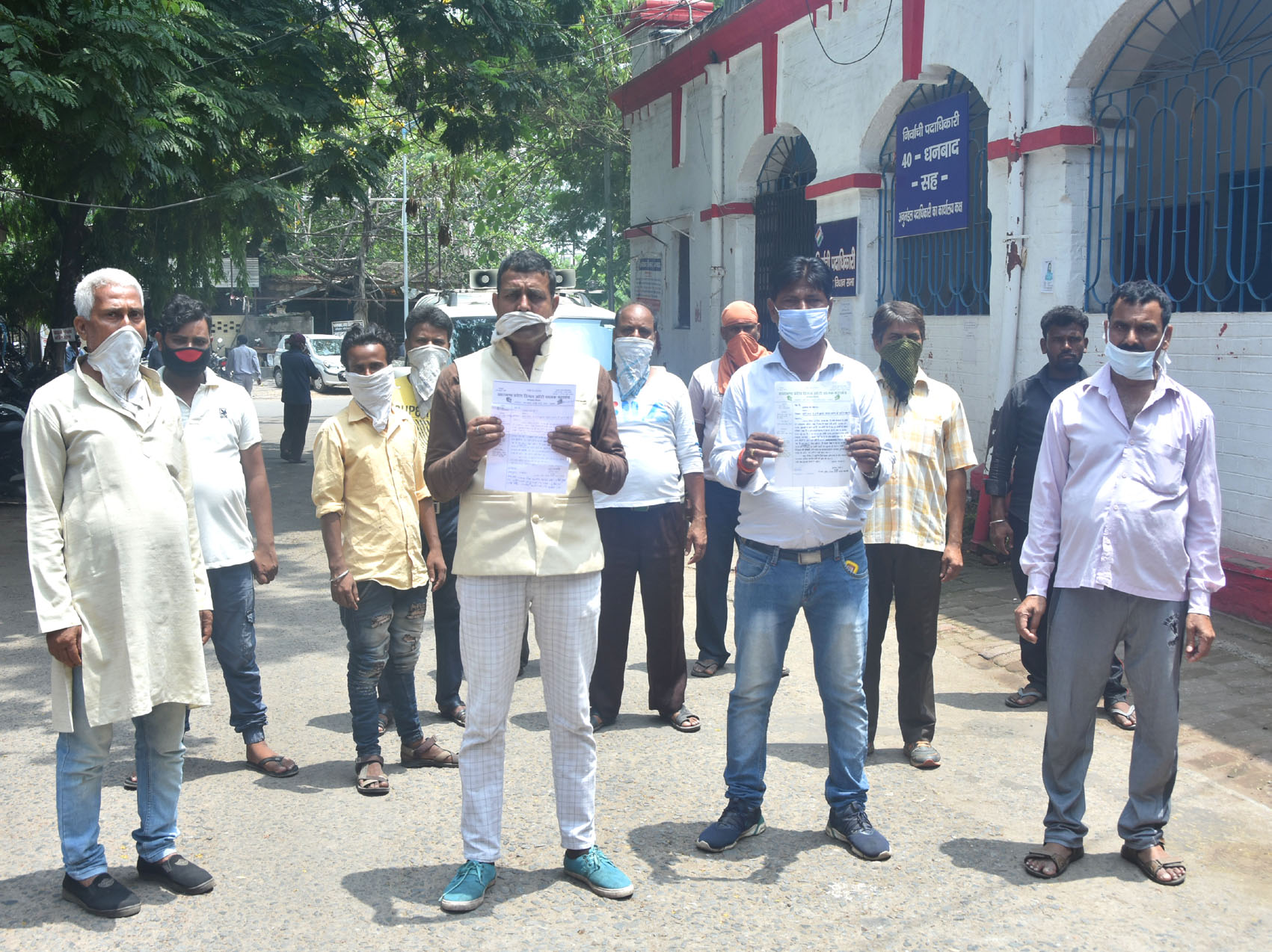 Auto drivers and the members of the Jharkhand Pradesh Diesel Auto Chalak Mahasangh, Dhanbad unit showing their charter of demands after meeting with Dhanbad SDM, Raj Maheshwaram in front of his office in Dhanbad today