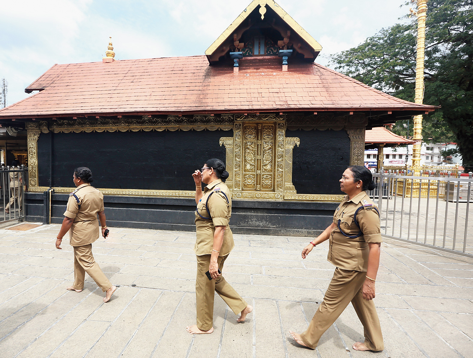 Policewomen over the age of 50 deployed at the Sabarimala temple circumambulate the main shrine on Monday, when it was opened for pilgrims for the second time since the Supreme Court verdict allowing women of all ages to enter.
