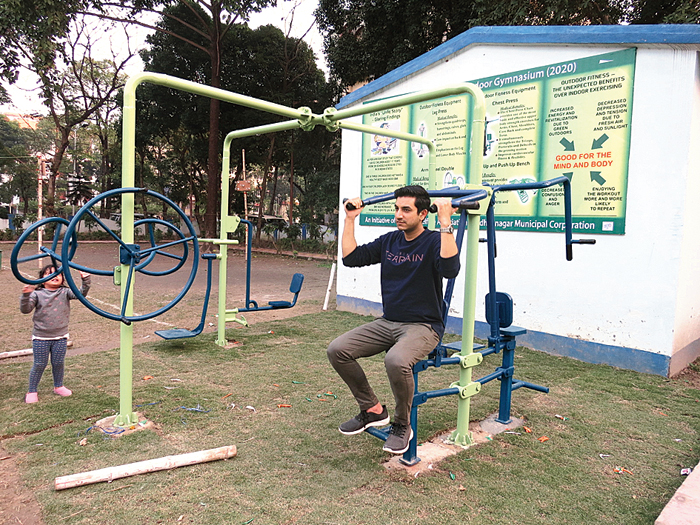 A resident of GC Block works out on the chest press in the park on Wednesday afternoon