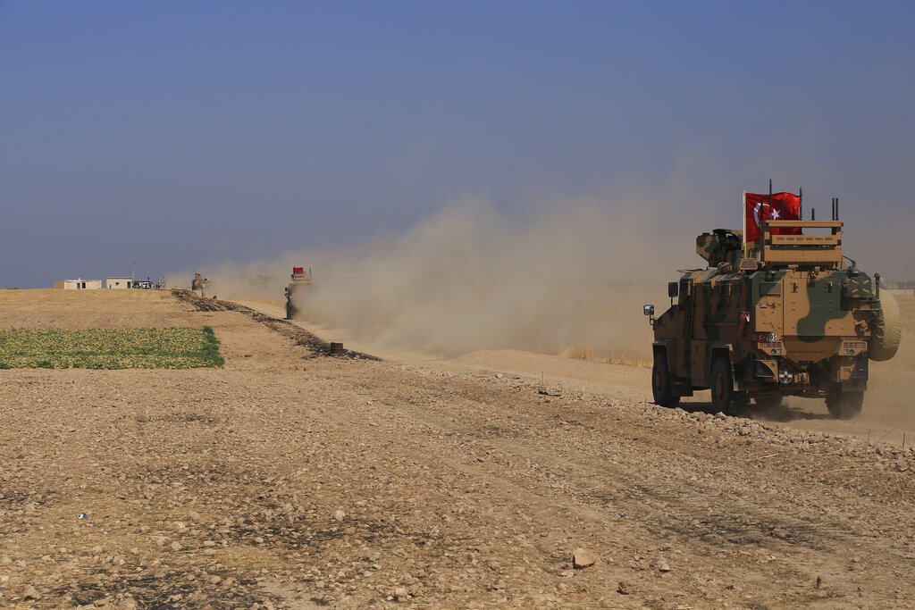 A Turkish armored vehicles patrol as they conduct a joint ground patrol with American forces in the so-called