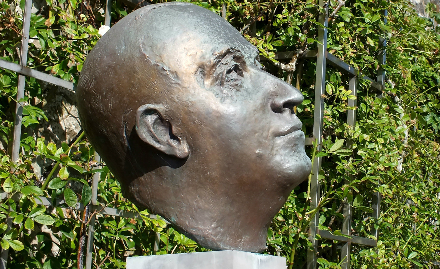 A bust of Christian Dior in the garden of the museum in his childhood home in Granville, France.