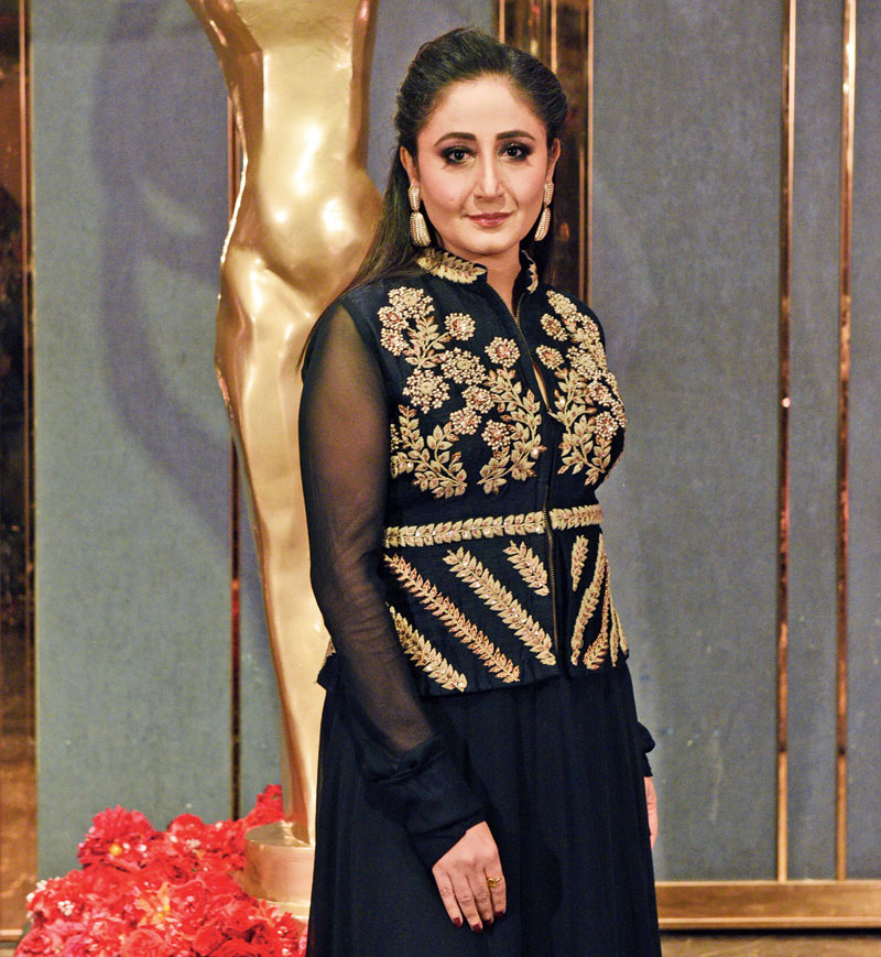 """The Emcee: Gitikka Ganju Dhar, the anchor for the evening, looked stunning in a black A-line long dress with thread and zari work, paired with a matching jacket. """"The Telegraph She Awards were grandly staged, with due aplomb. The awardees were thoroughly deserving, it was evident that the jury had made a great effort to honour those most worthy of the award. I was very happy to host the proceedings amongst such stellar women achievers in Calcutta,"""" said the award-winning emcee and anchor from Mumbai."""