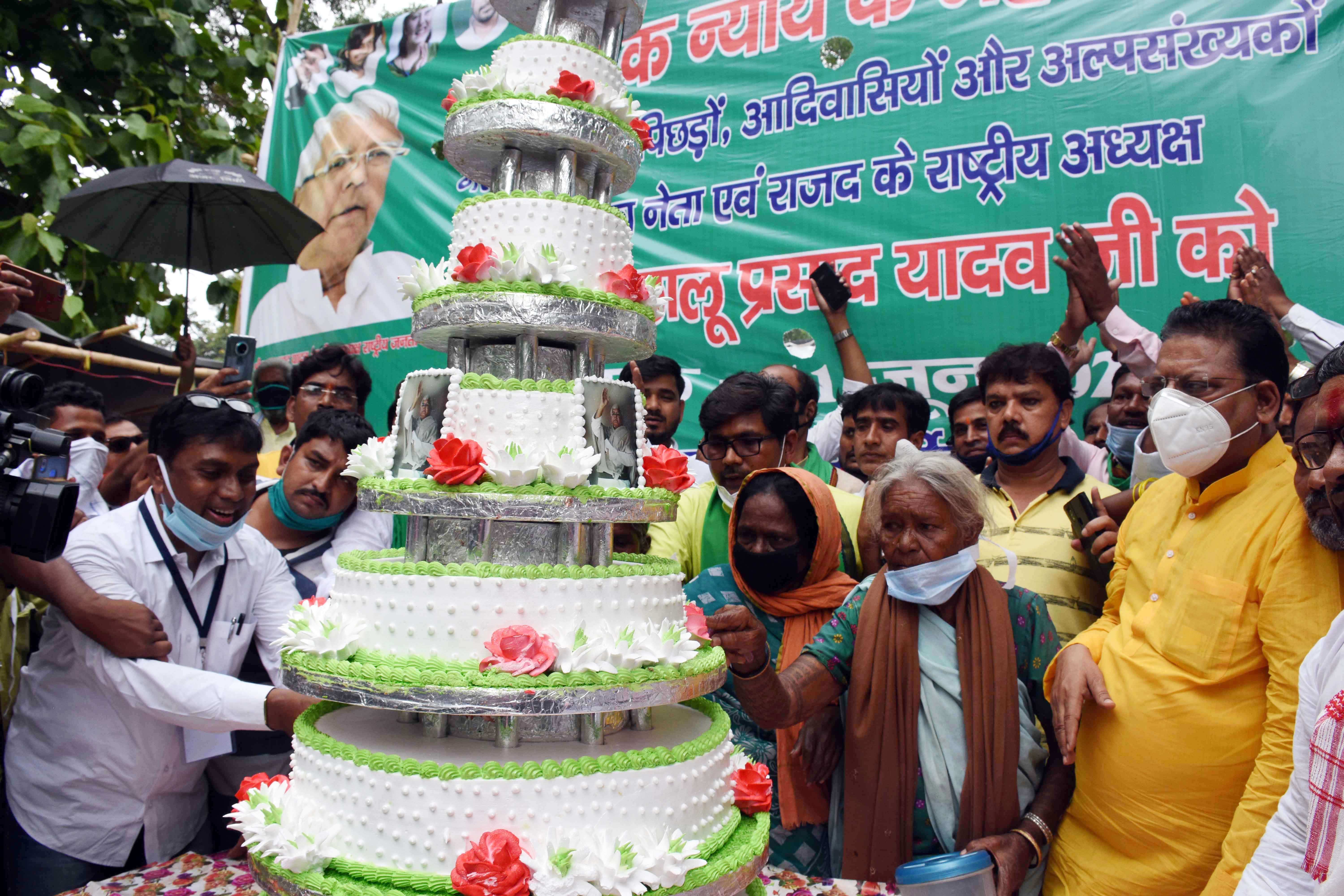 RJD workers and supporters celebrate Lalu Prasad's 73rd birthday at RIMS by cutting a 73-pound cake on RIMS campus in Ranchi on Thursday