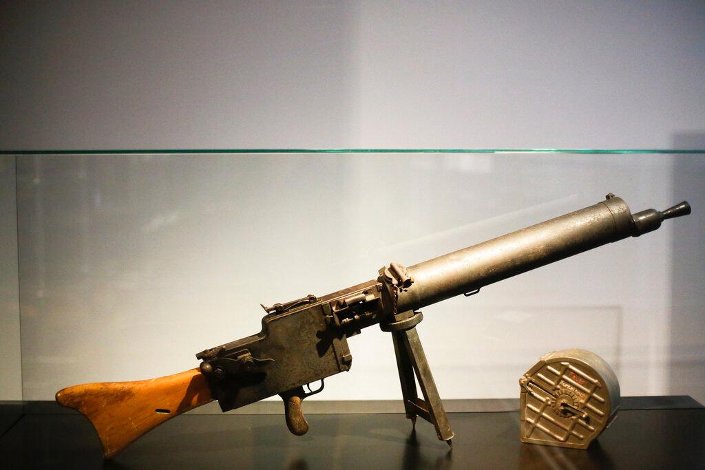 In this Wednesday, April 3, 2019 photo, a historic gun is displayed at the exhibition 'Weimar: The Essence And Value Of Democracy' at the German Historical Museum in Berlin, Germany.