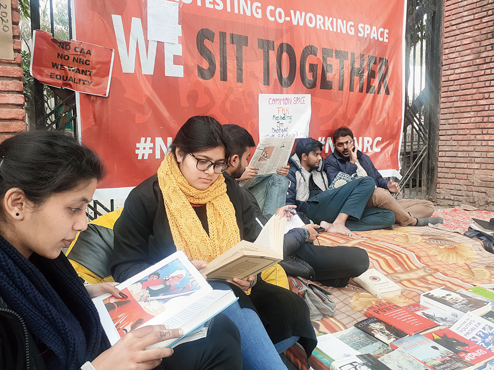 Tehreem Roshan and Hashmat Naiyareen (wearing a yellow muffler) at the Read for Revolution reading lounge outside Jamia Millia Islamia