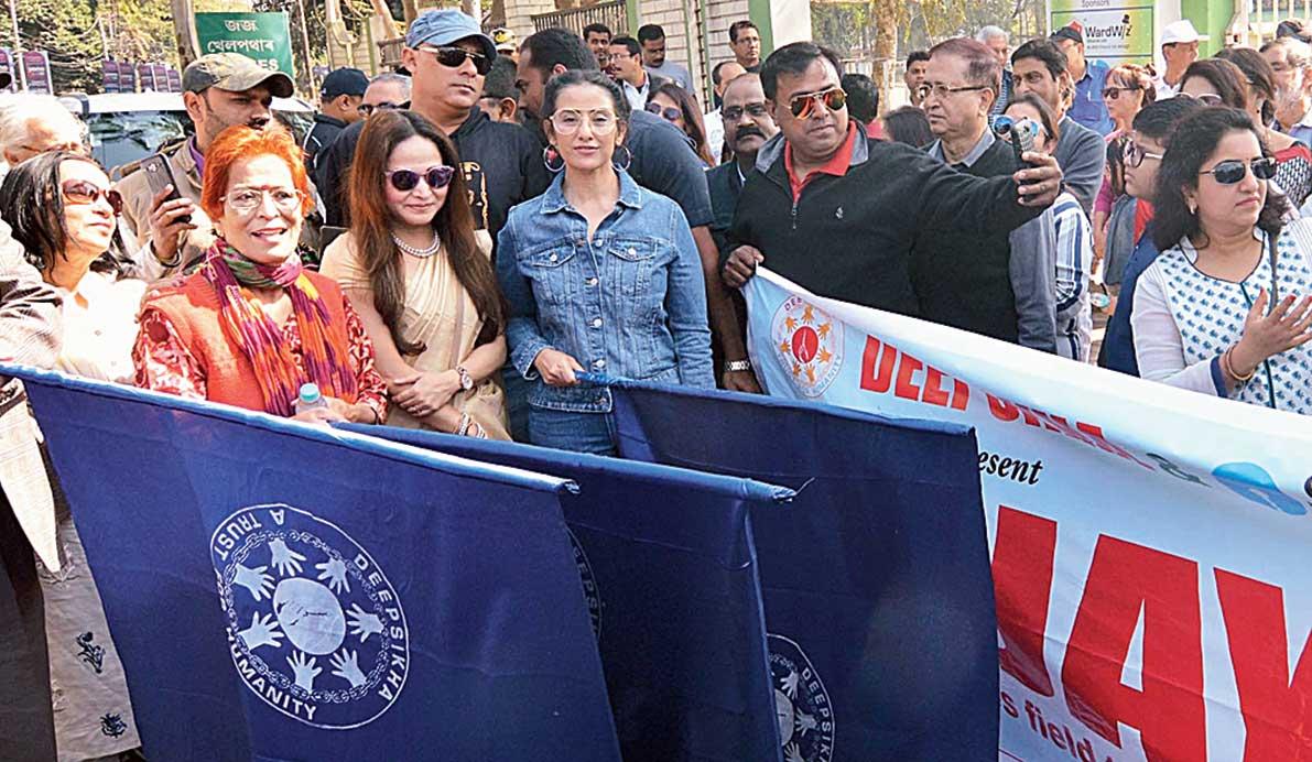 Actresses Manisha Koirala and Zerifa Wahid flag off the walk in Guwahati on Sunday.