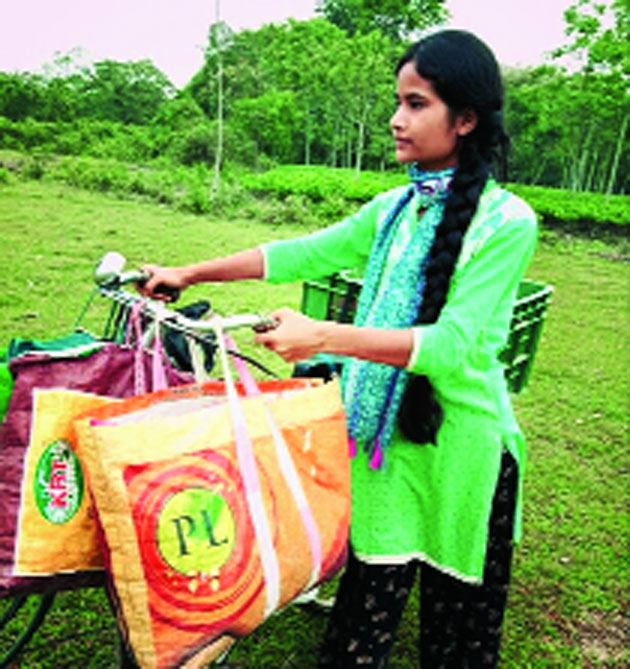 Janmoni Gogoi sells vegetables on a bicycle in Dibrugarh.