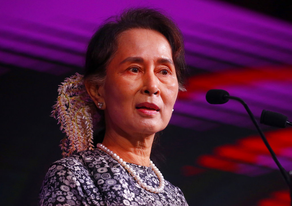 Aung San Suu Kyi speaks at an Asean business forum in Singapore on Monday.