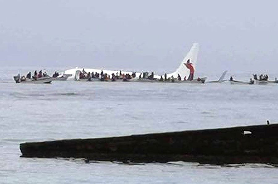The Air Niugini plane floats in the Pacific lagoon after crash-landing.