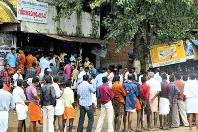 Regular queue at a liquor shop in Kerala.