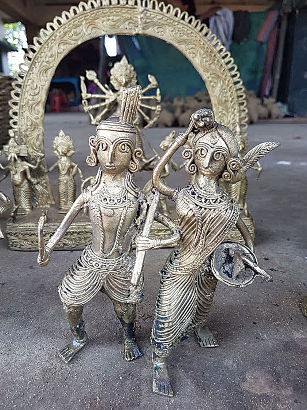 "Drive into Bikna, a dokra village, to watch artisans create the beautiful metallic figurines. ""We are about 75 families living here and dokra has been our profession for generations,"" said Subhankar Rana, one of the artisans. Prices are less than those in the city too"