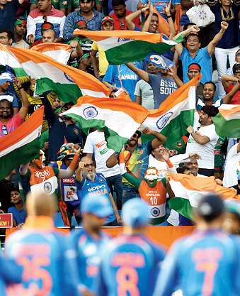 Indian cricket fans cheer in support of their national team during the final one day international (ODI) Asia Cup cricket match between Bangladesh and India at the Dubai International Cricket Stadium in Dubai on September 28, 2018.