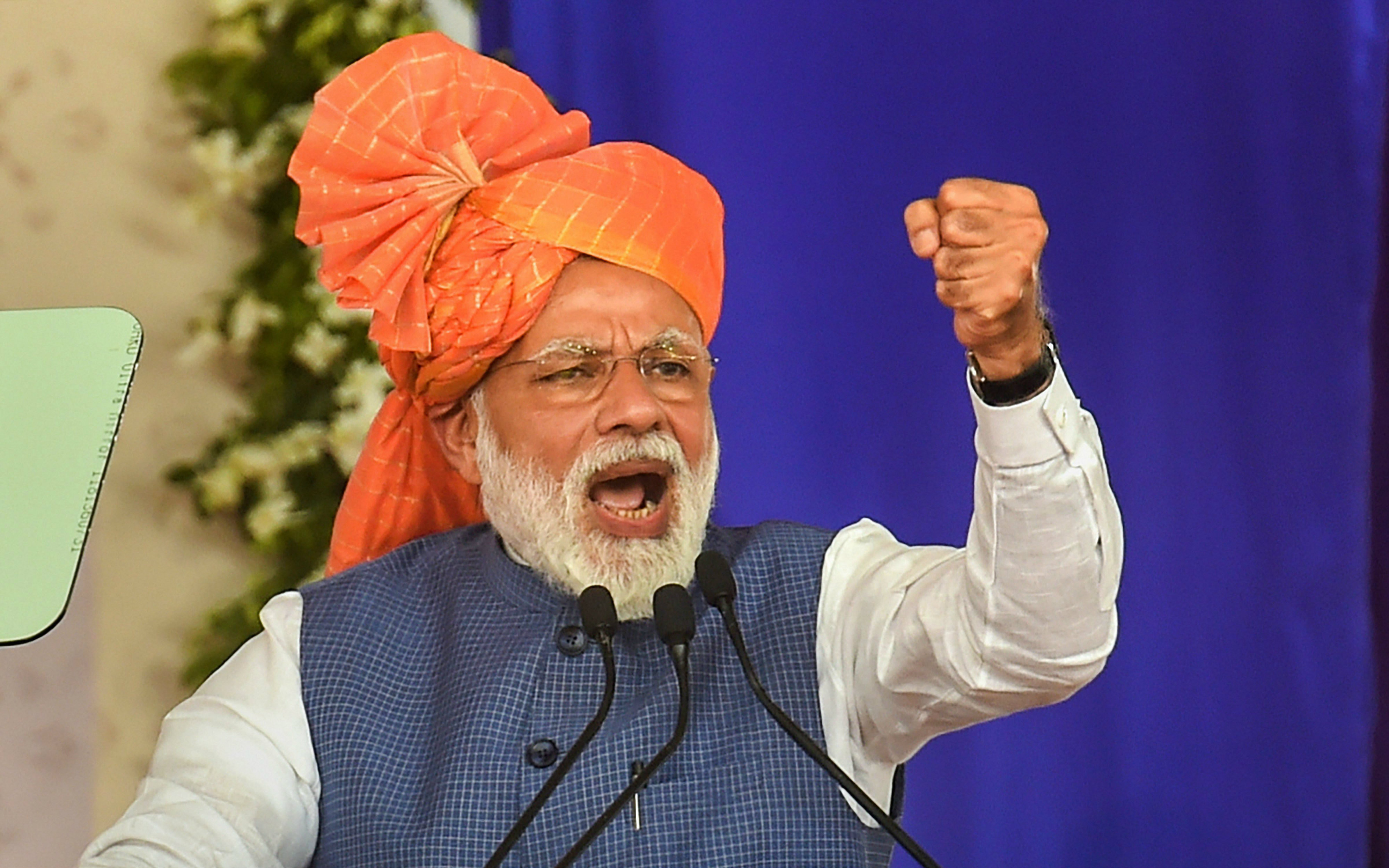 Narendra Modi launches the Pradhan Mantri Shram Yogi Pension Yojana for unorganised workers in Ahmedabad on Tuesday.