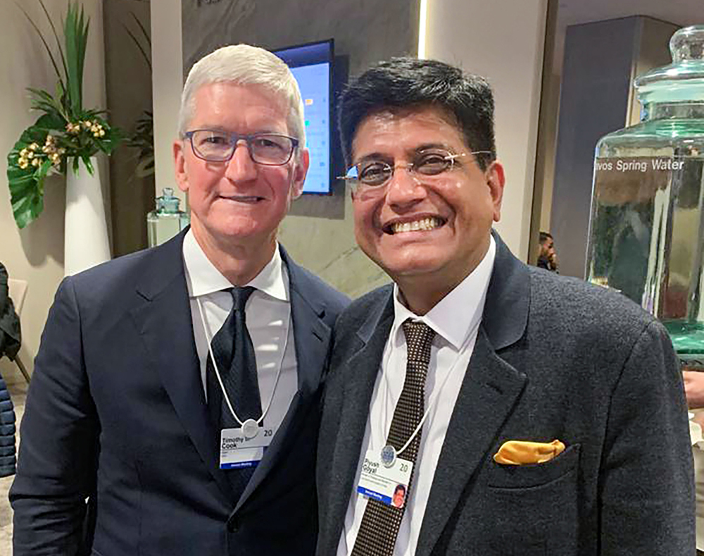 Piyush Goyal with Apple's Tim Cook at WEF Davos on January 23