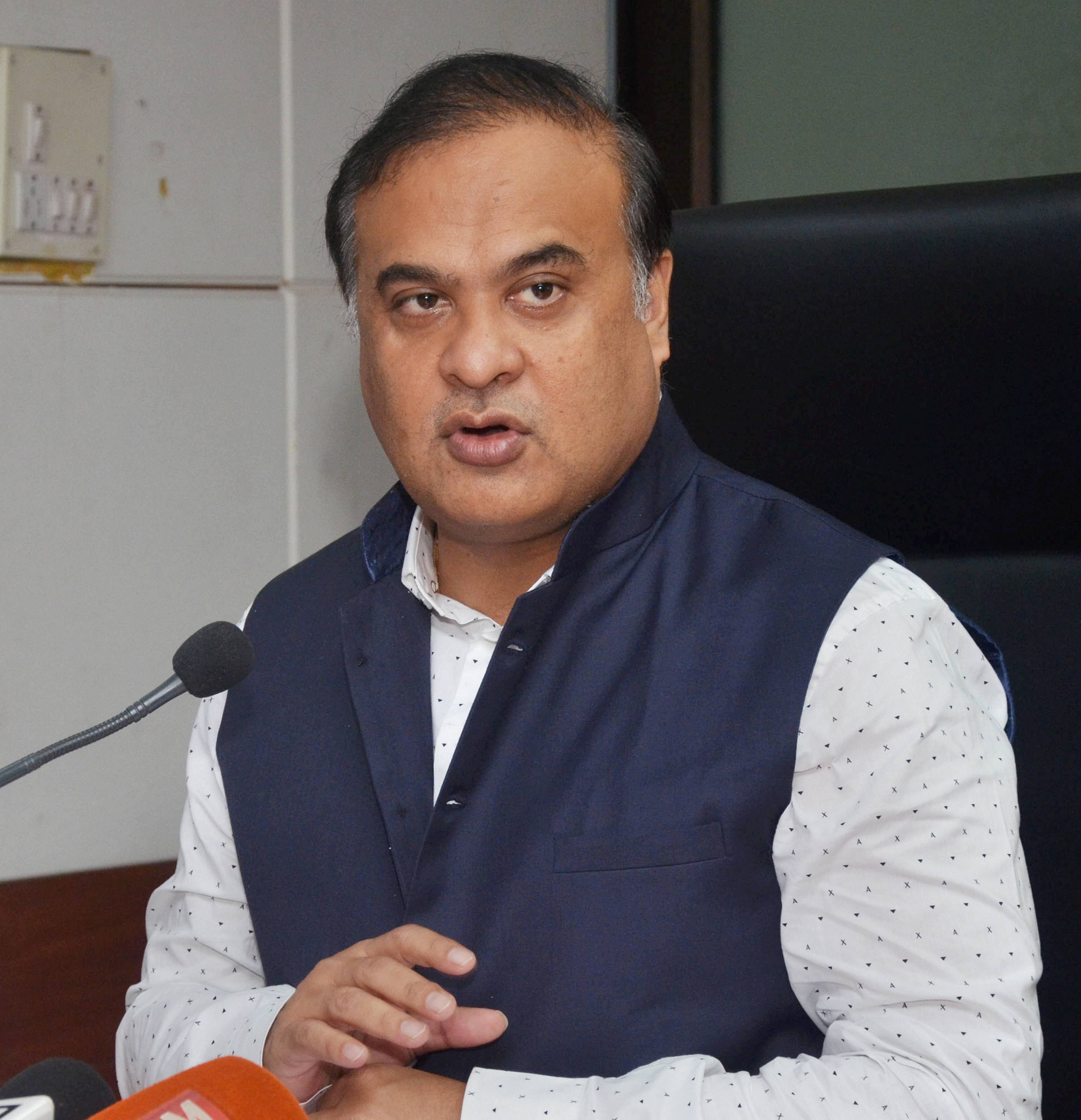 Assam health minister Himanta Biswa Sarma announces the lockdown at a news conference in Guwahati on Friday.