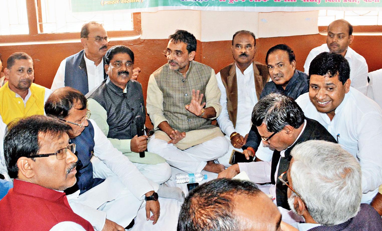 Upendra Kushwaha (centre) in a meeting with his RLSP colleagues at Panchayat Parishad in Patna on Saturday.